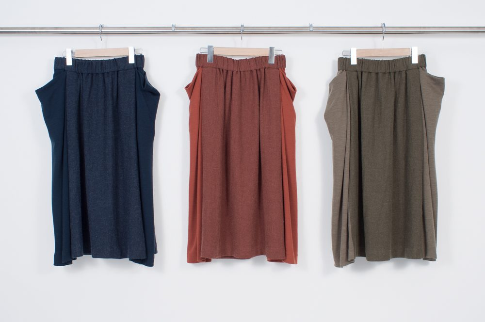 Side drape switching skirt